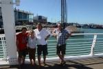 Wojtek, Michele, Mariusz i Adam na tle jachtów Volvo Ocean Race