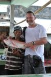 Kuba z rybakiem i kupioną rybą