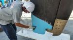 prace nad uszkodzoną płetwą sterową